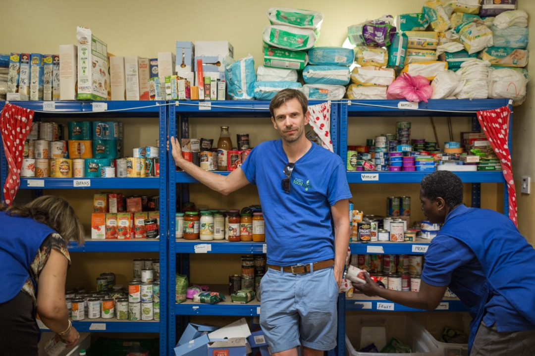 Jon Taylor with volunteers at the Brixton Foodbank. Photo by James Hopkirk